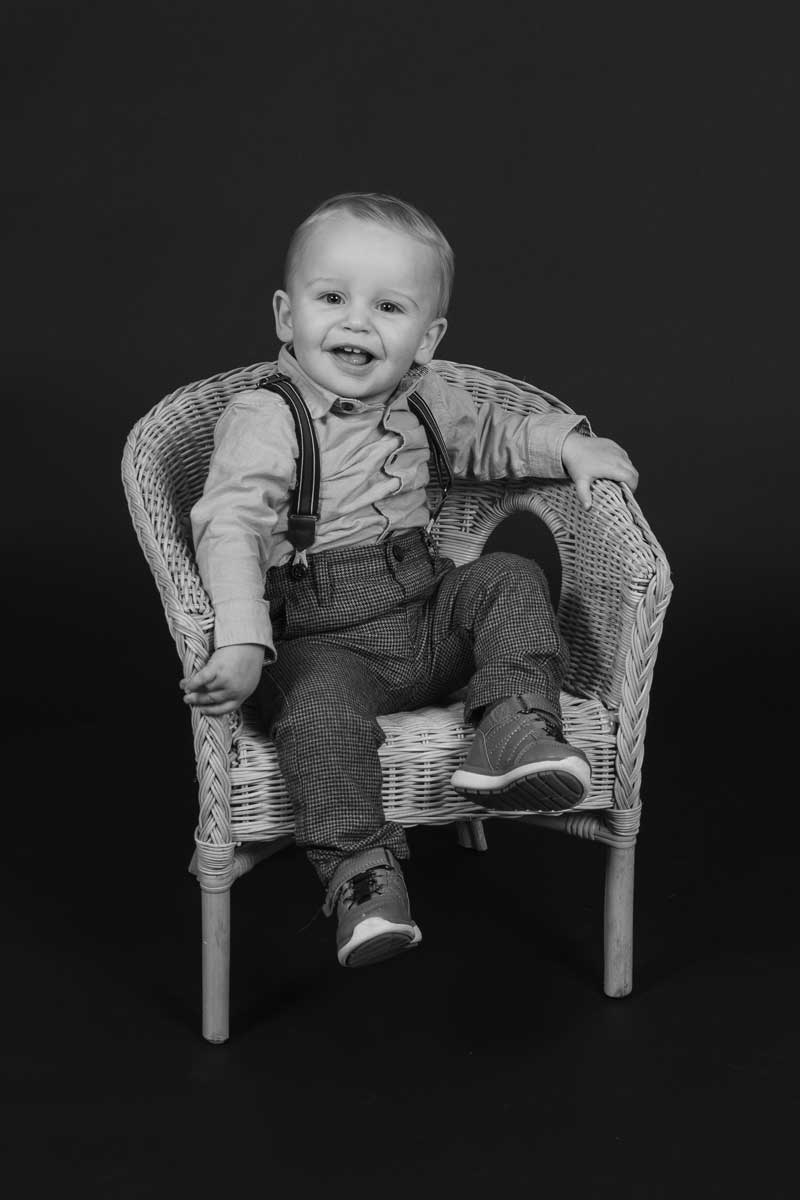 1 year old posing in chair